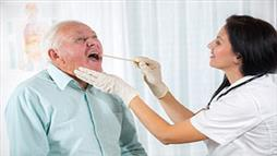 doctor checking throat