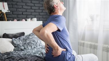 elder woman having lower back pain