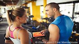Woman discussing workout with trainer