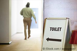 a man going to the toilet