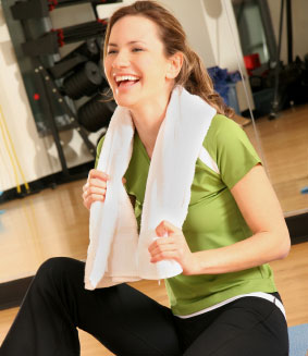 Woman laughs after a workout