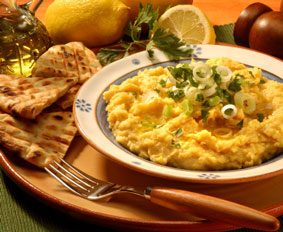 Freshly made hummus topped with spring onion, parsley and olive oil, served with toasted pita bread and lemon.