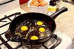 cooking eggs on skillet