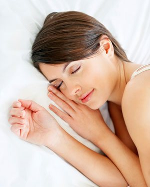 girl sleeping on a cotton bed sheet