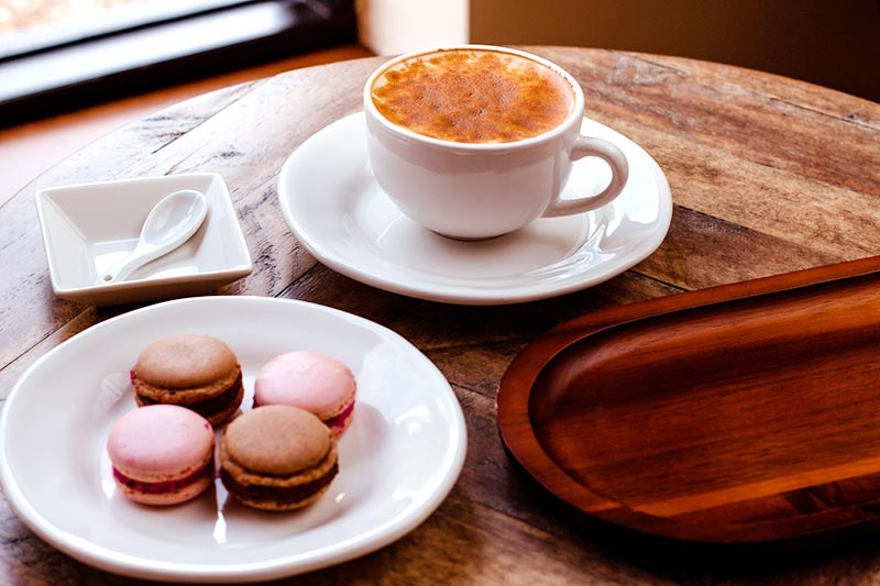 Coffee with macarons on the table