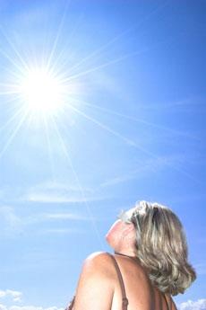 woman facing the sun