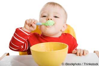 baby eating his breakfast