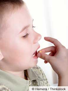 boy drinking antibiotics