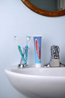 toothbrush, bathroom sink