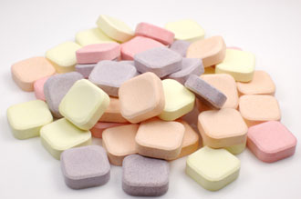 pile of antacid tablets