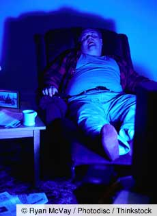 Man Sleeping With TV on
