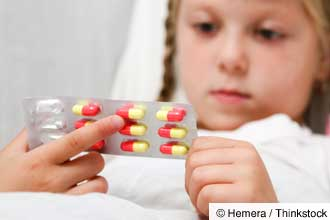 girl holding medicine capsules