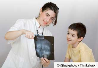 Doctor examining child's X-ray.