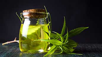 Cannabisöl und Marihuanablätter